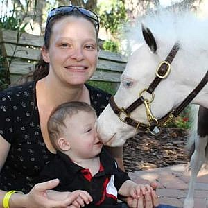 Cassey and her baby Robert play with one of the Gentle Carousel Miniature Therapy Horses