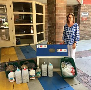 Talbot Elementary School Principle Nannette Dell poses with pop tabs collected by the school's faculty and families